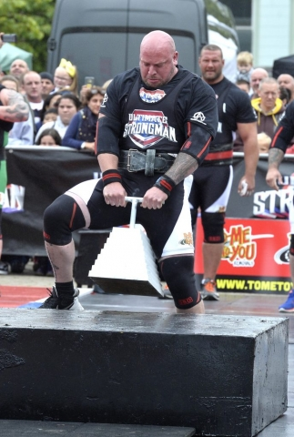 England's Strongest Man Phil Roberts gets England underway in the Farmers Walk Steeplechase.