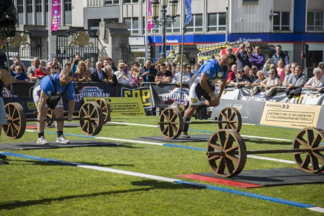 Laurence Shahlaei moves ahead of Paul Smith (L) in the Axle Deadlift Medley